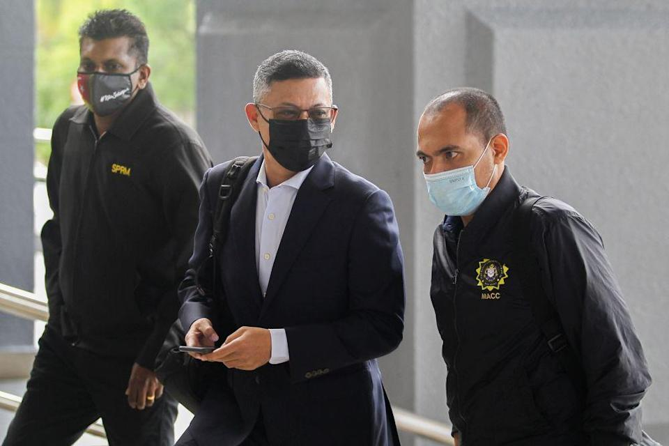 Former 1MDB chief executive officer Mohd Hazem Abdul Rahman arrives at the Kuala Lumpur High Court May 17, 2021. — Picture by Miera Zulyana