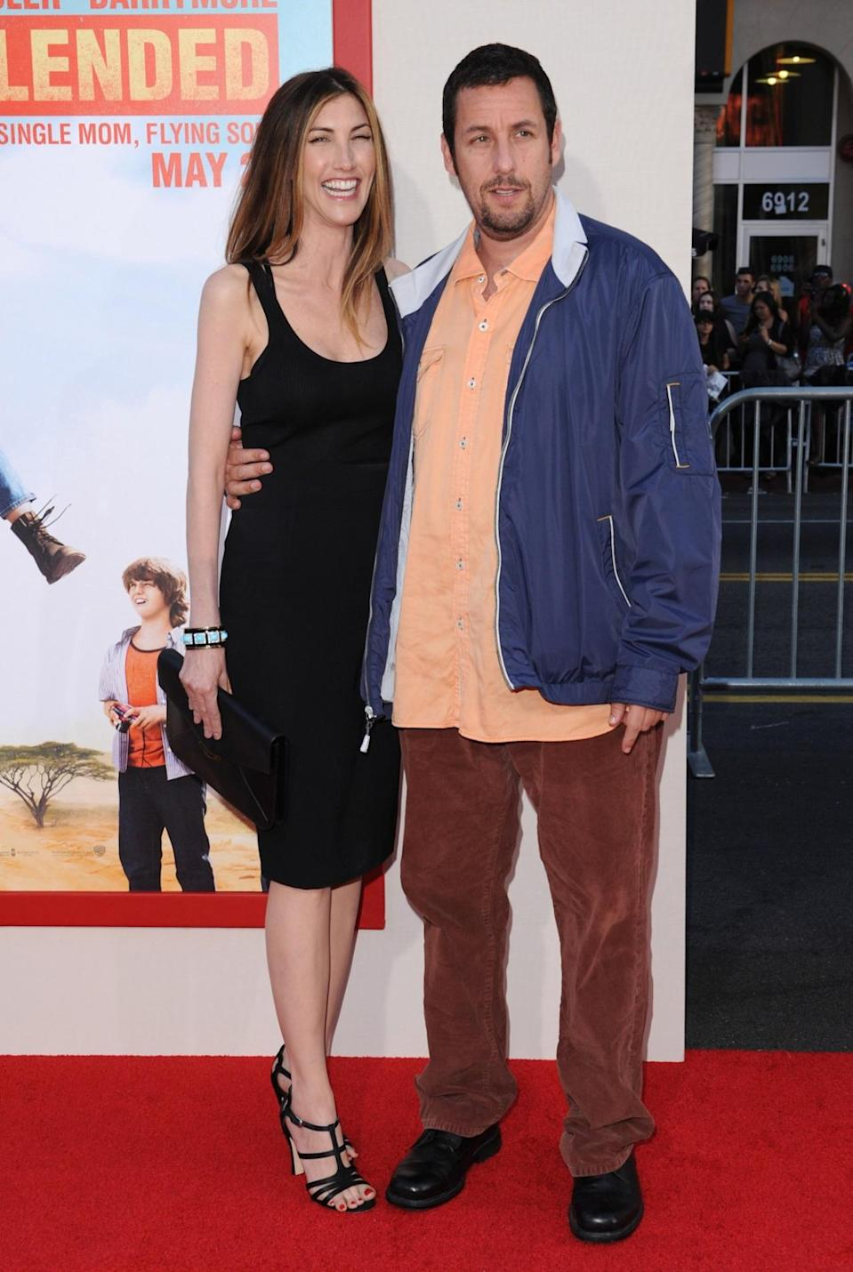 <p>Sandler threw on another mismatched outfit for the Hollywood premiere of <i>Blended</i> in 2014, while wife, Jackie, opted for a classic LBD. She loves her man no matter what he wears! (Photo: Axelle/Bauer-Griffin/FilmMagic)</p>