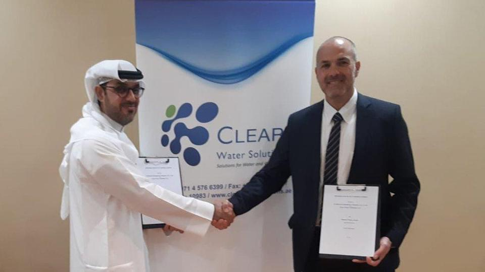 Thani al-Shirawi of the Al Shirawi Group and an executive from the Israeli water company Fluence shaking hands after one of the first memorandums of understandings after the peace deal