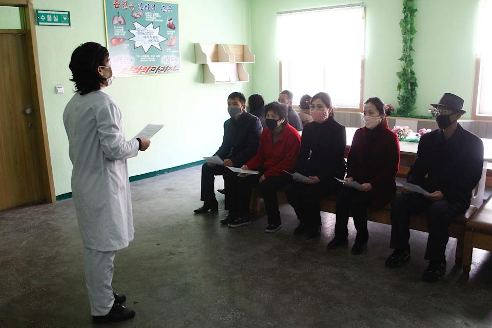 "A nurse explains details about the COVID-19 and ways to prevent contracting the new virus at the Phyongchon District People's Hospital in Pyongyang, April 1, 2020 <p class=""copyright"">AP Photo/Jon Chol Jin</p>"