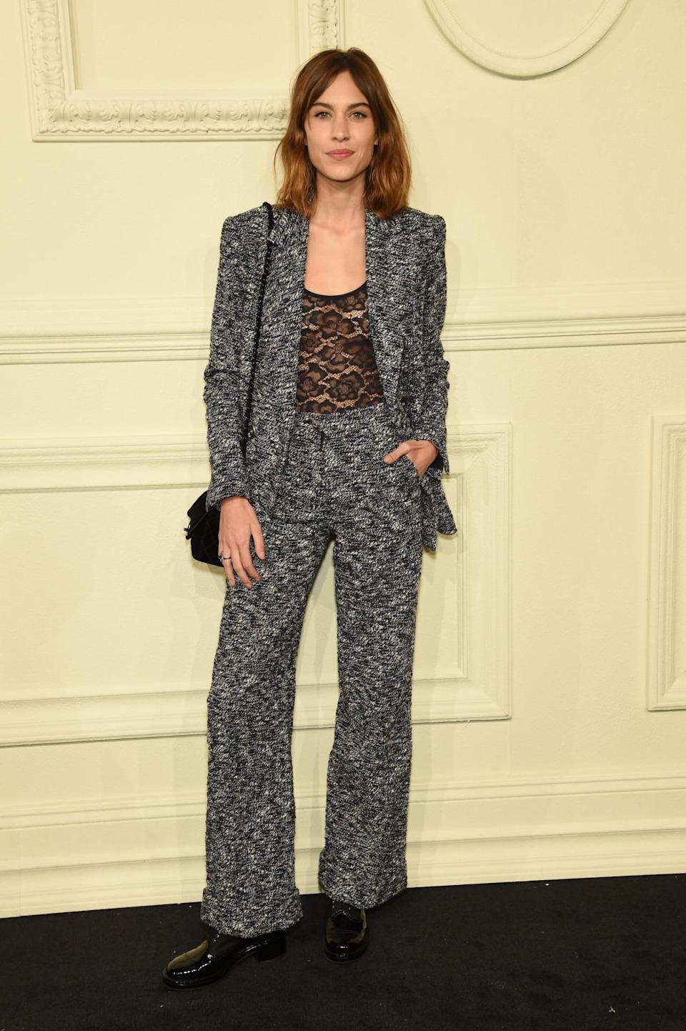 <p>The British model/designer/host looked rock-and-roll chic in a tweed suit with flared trousers.</p>