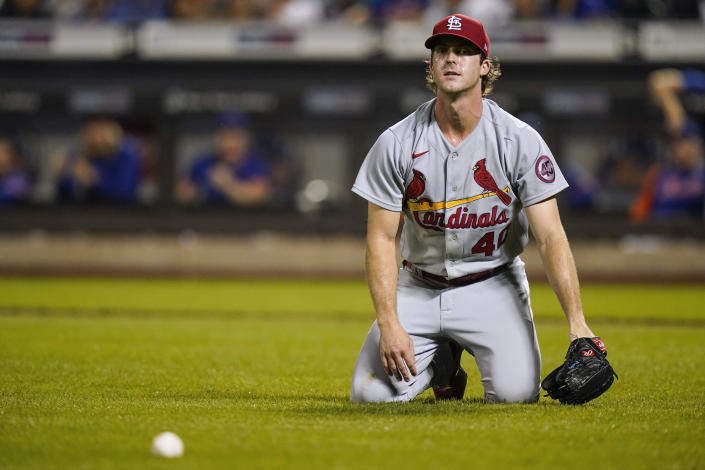 St. Louis Cardinals starting pitcher Jake Woodford reacts to an RBI bunt single by New York Mets' Javier Baez during the first inning of a baseball game Tuesday, Sept. 14, 2021, in New York. (AP Photo/Frank Franklin II)