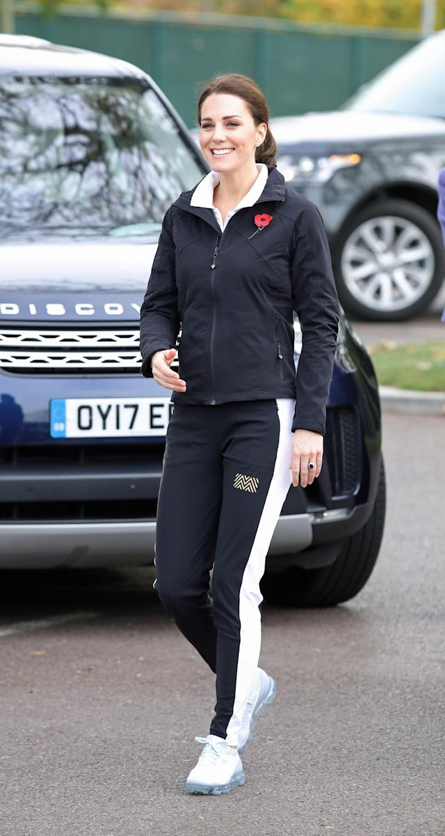 Kate Middleton opted for a comfy tracksuit and Nike sneakers for her first solo engagement since announcing her third pregnancy. (Photo: PA)