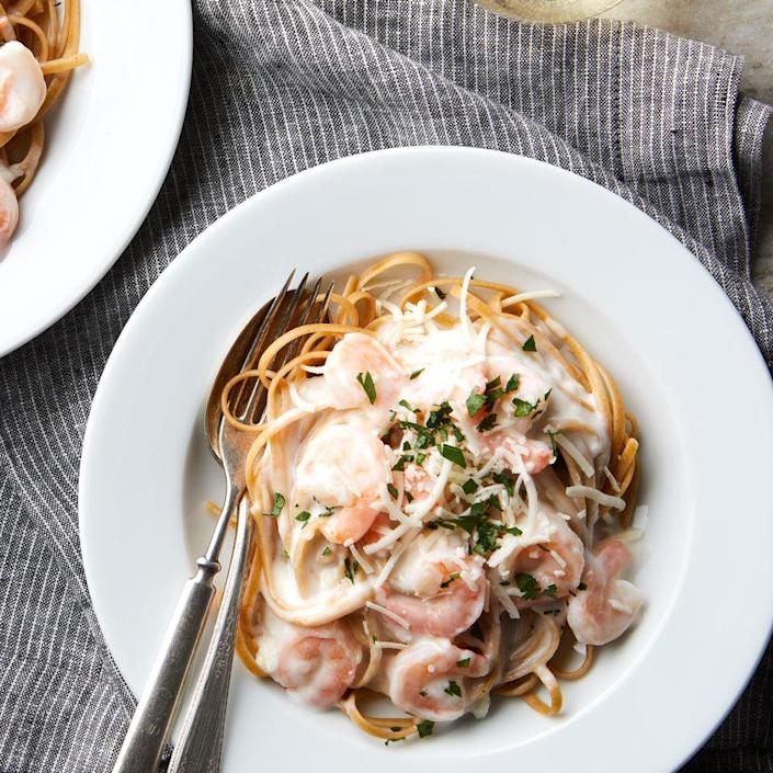 "<p>Healthify classic fettuccine Alfredo by adding protein-rich shrimp and using whole-wheat noodles instead of white for extra fiber. We love the full flavor of Asiago cheese in this quick and comforting dinner, but any hard Italian cheese, like Parmigiano Reggiano or Romano, will work well too. <a href=""http://www.eatingwell.com/recipe/262566/shrimp-alfredo/"" rel=""nofollow noopener"" target=""_blank"" data-ylk=""slk:View recipe"" class=""link rapid-noclick-resp""> View recipe </a></p>"