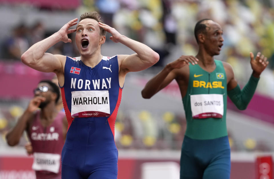 Karsten Warholm, of Norway celebrates as he wins the gold medal in the final of the men's 400-meter hurdles at the 2020 Summer Olympics, Tuesday, Aug. 3, 2021, in Tokyo, Japan. (AP Photo/Martin Meissner)