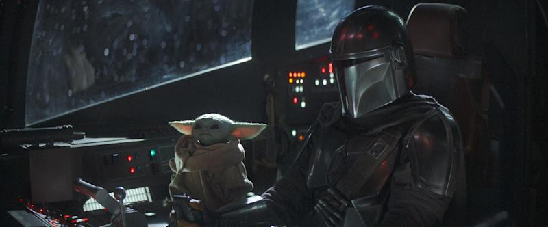 THE MANDALORIAN, from left: The Child, Pedro Pascal (as the Bounty Hunter), 'Chapter 4: Sanctuary', (Season 1, ep. 104, aired Nov. 29, 2019). photo: Disney+/Lucasfilm / courtesy Everett Collection