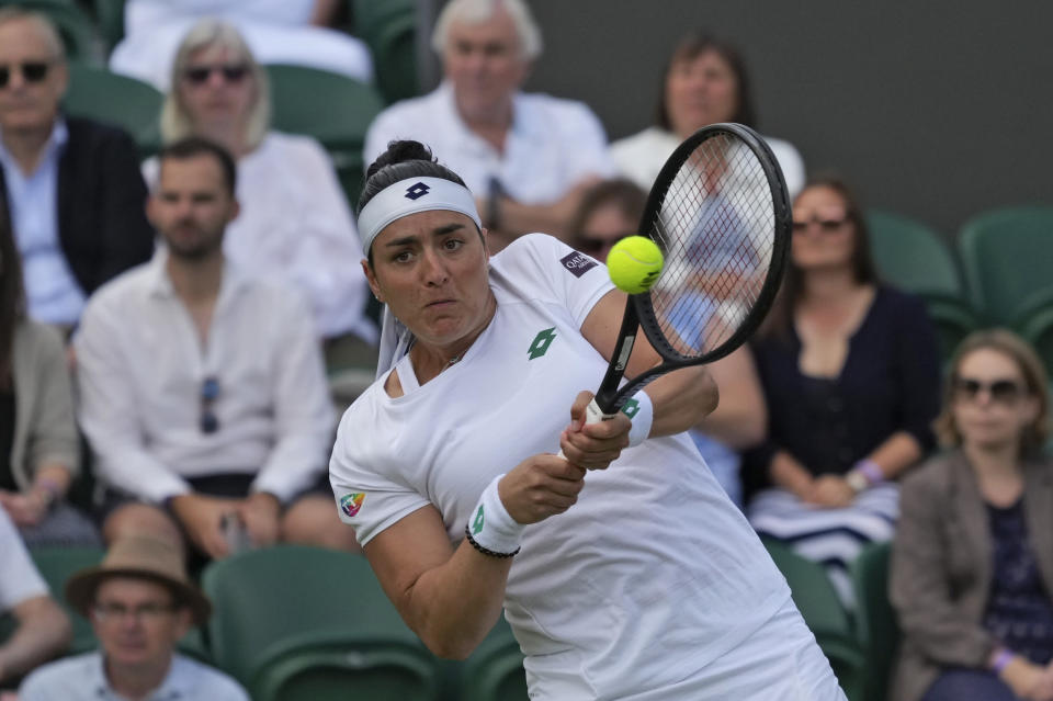 Tunisia's Ons Jabeur plays a return against Poland's Iga Swiatek during the women's singles fourth round match on day seven of the Wimbledon Tennis Championships in London, Monday, July 5, 2021. (AP Photo/Alberto Pezzali)