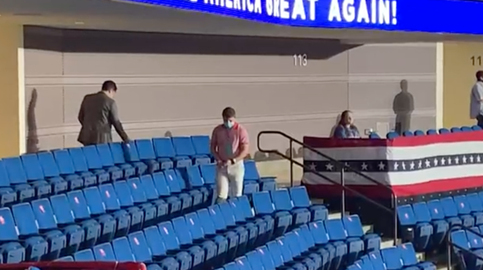 These two men were filmed removing the stickers hours before the Trump rally began. Source: The Washington Post