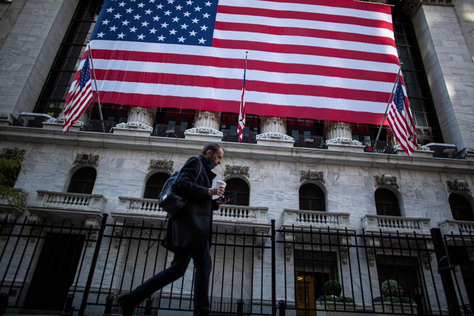 A man walks by the New York Stock Exchange (NYSE) on November 4, 2020 in New York.