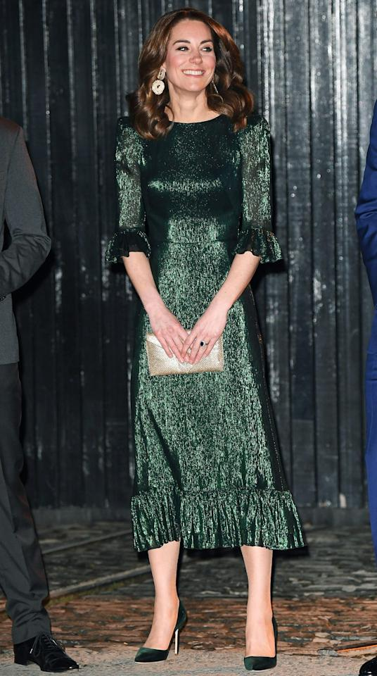 """<p>Prince William and Kate Middleton attended <a href=""""https://people.com/royals/raise-a-glass-kate-middleton-and-prince-william-attend-reception-at-guinness-storehouse-in-dublin/"""">a reception held at the Gravity bar at the Guinness Storehouse in Dublin</a>. Kate looked dazzling in a metallic emerald green midi dress by <a href=""""https://click.linksynergy.com/deeplink?id=93xLBvPhAeE&mid=37385&murl=https%3A%2F%2Fwww.modaoperandi.com%2Fthe-vampire-s-wife%2Fwomen&u1=PEO%2CEverythingYouNeedtoCopyKateMiddleton%E2%80%99sSpringStyle%2Ckphillip%2CRoy%2CGal%2C7706765%2C202003%2CI"""" target=""""_blank"""" rel=""""nofollow"""">The Vampire's Wife</a>, emerald velvet Manolo Blahnik pumps, and a gold clutch.</p><p><strong>Get the Look!</strong></p><p>MakeMeChic Zip Back Long Sleeve Glitter Dress, $22.99–$36.99; <a href=""""https://www.amazon.com/MAKEMECHIC-Womens-Sleeve-Glitter-Dresses/dp/B07SQ8KDRB/ref=as_li_ss_tl?ie=UTF8&linkCode=ll1&tag=poamzfkatemiddletonspringstylekphillips0320-20&linkId=f0716fb1e81cfb04ad1a30eb87284ea2&language=en_US"""">amazon.com</a></p><p>Closet London High Neck Belted Midi Dress in Forest Green, $106; <a href=""""https://click.linksynergy.com/deeplink?id=93xLBvPhAeE&mid=35719&murl=https%3A%2F%2Fwww.asos.com%2Fus%2Fcloset-london%2Fcloset-london-high-neck-belted-midi-dress-in-forest-green%2Fprd%2F13249022&u1=PEO%2CEverythingYouNeedtoCopyKateMiddleton%E2%80%99sSpringStyle%2Ckphillip%2CRoy%2CGal%2C7706765%2C202003%2CI"""" target=""""_blank"""" rel=""""nofollow"""">asos.com</a></p><p>Romwe Glitter Deep V Neck Long Sleeve Ruffle Bodycon Dress, $24.99–$25.99; <a href=""""https://www.amazon.com/Romwe-Womens-Glitter-Sleeve-Bodycon/dp/B07SSR4TKM/ref=as_li_ss_tl?ie=UTF8&linkCode=ll1&tag=poamzfkatemiddletonspringstylekphillips0320-20&linkId=30a1b2a0679516ce5a5596fa6f5f59c6&language=en_US"""">amazon.com</a></p><p>Lulu's Falling Star Metallic V-Neck Gown, $84; <a href=""""https://click.linksynergy.com/deeplink?id=93xLBvPhAeE&mid=1237&murl=https%3A%2F%2Fshop.nordstrom.com%2Fs%2Flulus-falling-star-metallic-v-neck-go"""