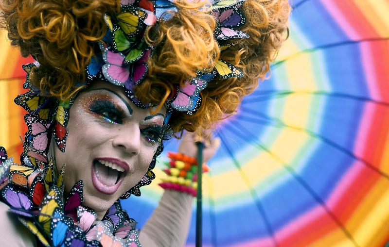 A reveller takes part in the annual Gay Pride Parade in Sao Paulo, Brazil on June 7, 2015 (AFP Photo/Miguel Schincariol)