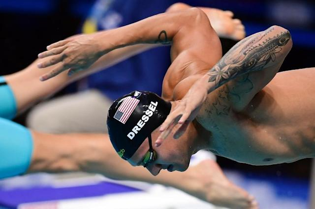 US swimmer Caeleb Dressel emerged from the shadow of his idol Michael Phelps in Budapest becoming the first swimmer to win three world championships gold medals in a single day (AFP Photo/Martin BUREAU)
