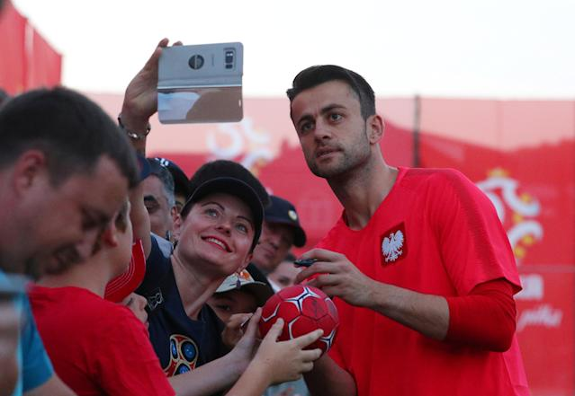 Soccer Football - World Cup - Poland Training - Sputnik Stadium, Sochi, Russia - June 13, 2018 Poland's Wojciech Szczesny poses for a picture with fans during training REUTERS/Hannah McKay