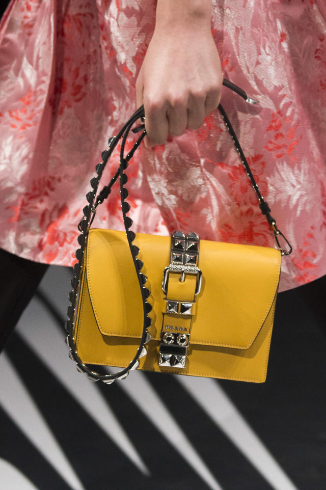 <p><i>Yellow studded strap buckle handbag from the SS18 Prada collection. (Photo: ImaxTree) </i></p>