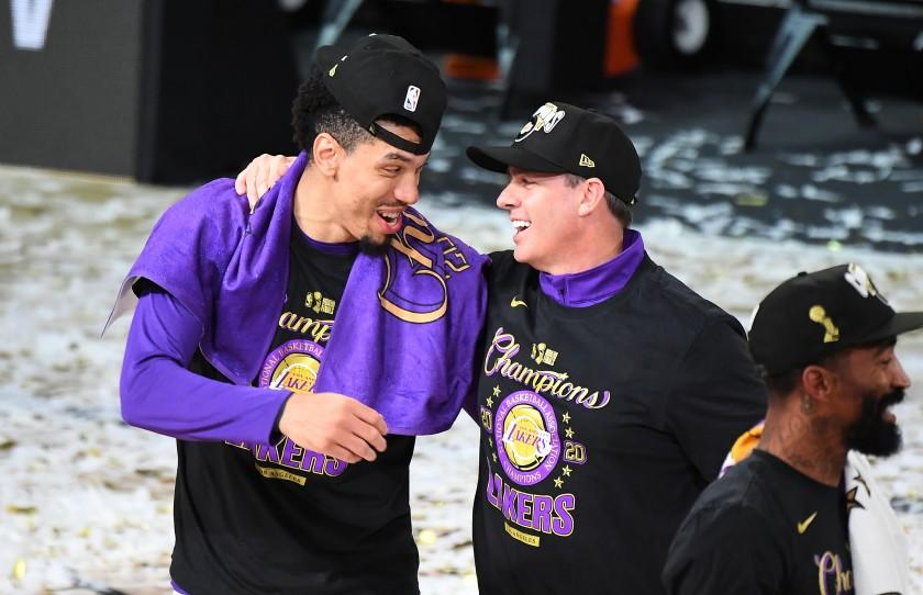 ORLANDO, FLORIDA OCTOBER 11, 2020-Lakers player Danny Green and head coach Frank Vogel celebrate the NBA Championship in Game 6 of the NBA FInals in Orlando Sunday. (Wally Skalij/Los Angeles Times)