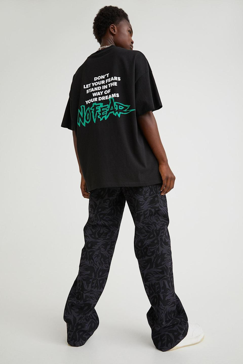 <p>A great black oversized t-shirt is always a good idea. This <span>No Fear x H&amp;M Oversized T-shirt</span> ($18) has a very cool graphic on the back that we can all get behind.</p>