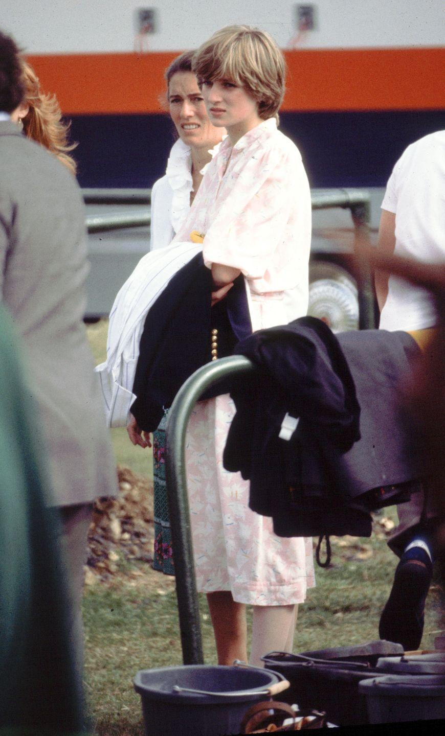 <p>Princess Diana watches from the sidelines as Prince Charles partakes in a polo match in 1981. </p>