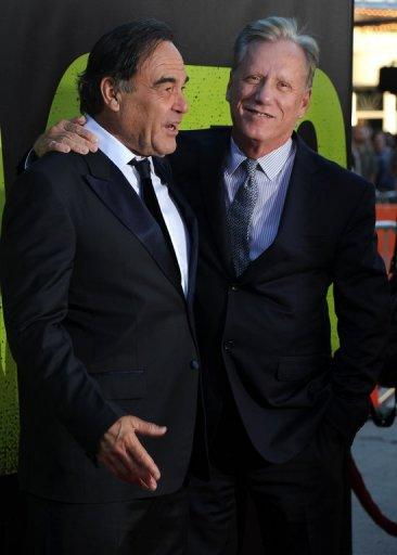 Director Oliver Stone and actor James Woods arrive for the premiere of 'Savages' at Westwood Village, on June 25, in Los Angeles, California. In what he stresses is fiction, Stone's 'Savages' returns to the theme of drugs and violence that helped make his name in 'Midnight Express' (1978) and 'Scarface' (1983)