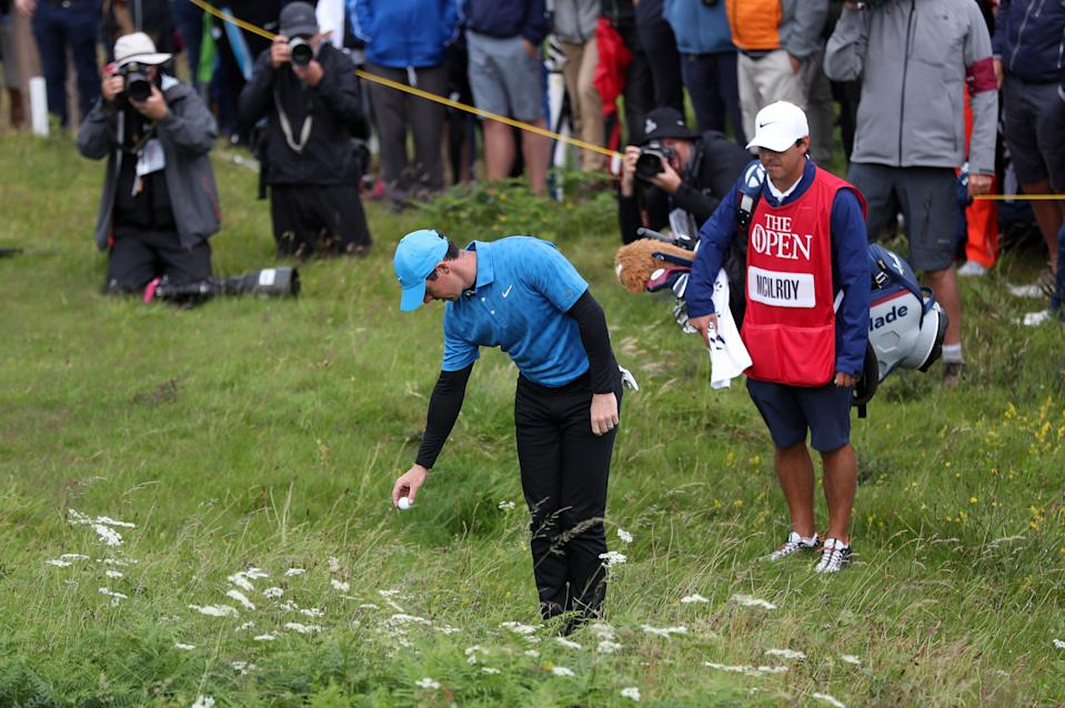 McIlroy takes a drop shot on the 1st during day one of The Open Championship