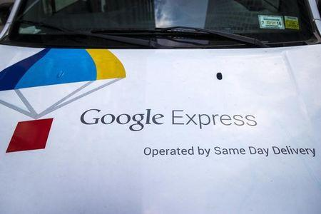 The Google Express logo is seen on one of its delivery trucks parked in New York