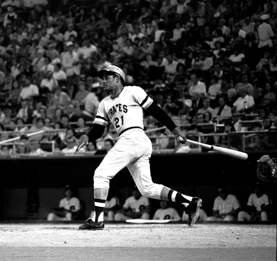 Roberto Clemente of the Pittsburgh Pirates drops his bat and heads for first base as he watches the ball get through the infield for a 4th inning hit Tuesday night, Sept. 26, 1972, against the Phillies in Philadelphia.