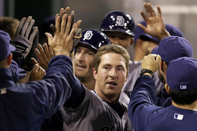 San Diego Padres' Jedd Gyorko, center, celebrates with teammates in the dugout after hitting a three-run home run off Pittsburgh Pirates starting pitcher Jeff Locke during the third inning of a baseball game in Pittsburgh, Tuesday, Sept. 17, 2013. (AP Photo/Gene J. Puskar)