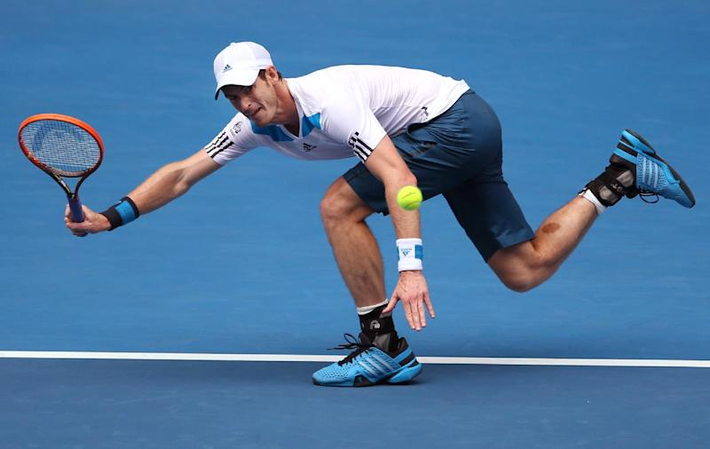 Andy Murray of Britain plays a shot to Feliciano Lopez of Spain during their third round match at the Australian Open tennis championship in Melbourne, Australia, Saturday, Jan. 18, 2014.(AP Photo/Rick Rycroft)