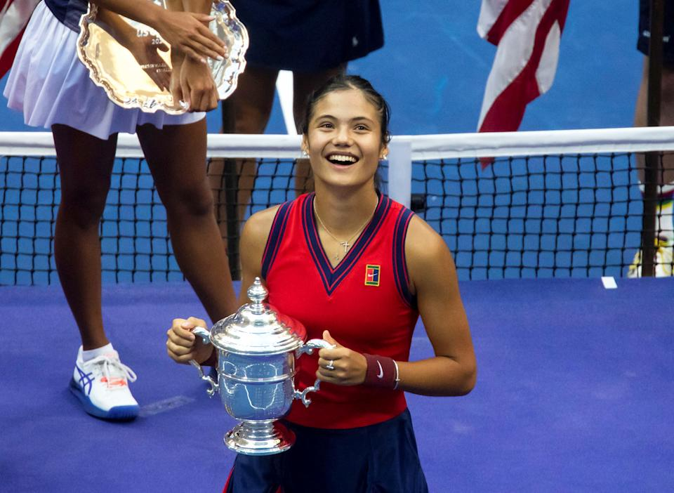 Emma Raducanu (pictured) smiles with the trophy during the awarding ceremony of the US Open.