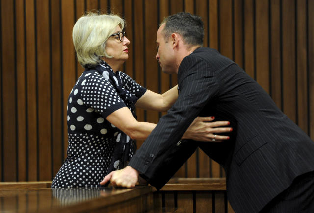 Oscar Pistorius, is greeted by his aunt Lois Pistorius, at court in Pretoria, South Africa, Tuesday, March 18, 2014. Pistorius is on trial for the murder of his girlfriend Reeva Steenkamp on Valentines Day, 2013. (AP Photo/Werner Beukes, Pool)