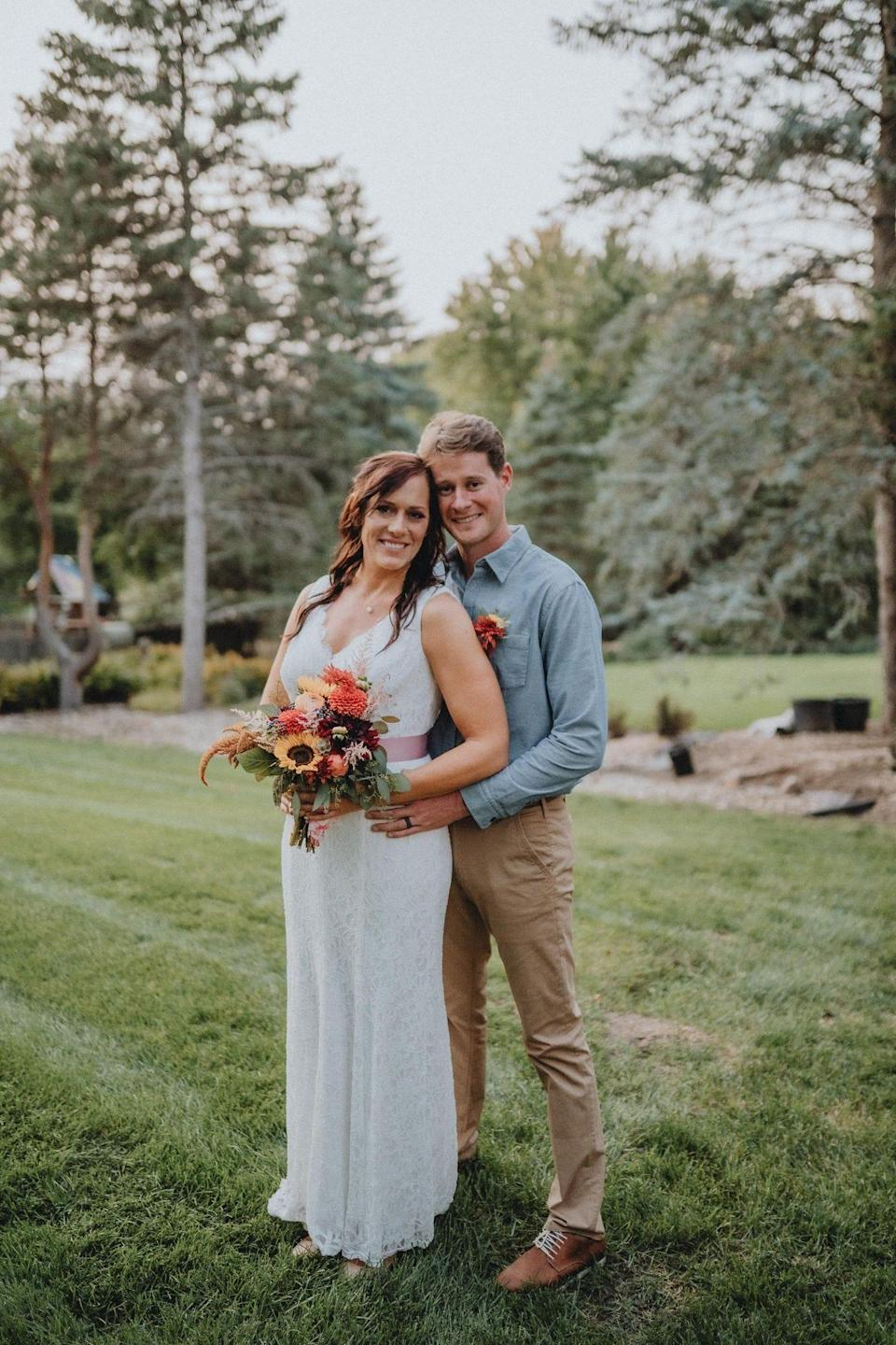 Tiaan and Samantha Treurnicht pose for a photo after getting married on Thursday September 9, 2021.