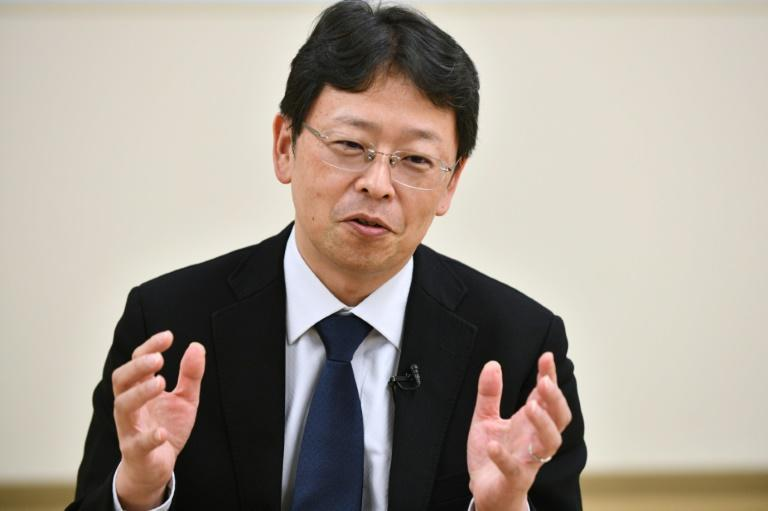 Japan may need to reconsider holding the Olympics if it cannot bring domestic transmissions of the new coronavirus under control, an expert has warned (AFP Photo/Kazuhiro NOGI)