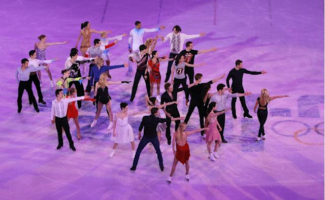 Skaters perform during the final of the figure skating exhibition gala at the Iceberg Skating Palace during the 2014 Winter Olympics, Saturday, Feb. 22, 2014, in Sochi, Russia. (AP Photo/Vadim Ghirda)