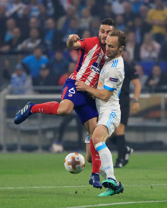 Soccer Football - Europa League Final - Olympique de Marseille vs Atletico Madrid - Groupama Stadium, Lyon, France - May 16, 2018 Atletico Madrid's Koke in action with Marseille's Valere Germain REUTERS/Gonzalo Fuentes