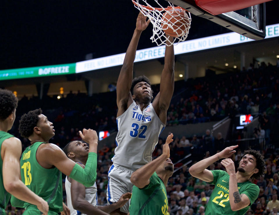 Memphis center James Wiseman (32) dunks against Oregon during the second half of an NCAA college basketball game in Portland, Ore., Tuesday, Nov. 12, 2019. Oregon won 82-74. (AP Photo/Craig Mitchelldyer)