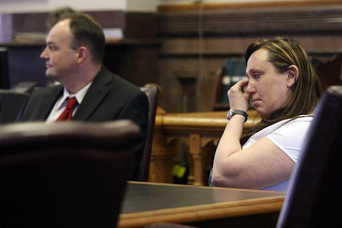 Kelli Jo Griffin, Montrose, Iowa, wipes away tears as she listens with her attorney Curtis Dial, left, to a not guilty verdict Thursday March 20, 2014 in Keokuk, Iowa. The former drug offender, who believed her voting rights had been restored when she cast a ballot last year, was acquitted of perjury - a public rebuke of Iowa's two-year investigation into voter fraud. It was the first trial stemming from the state's voter fraud investigation championed by Secretary of State Matt Schultz, a Republican. (AP Photo/The Hawk Eye, John Gaines)
