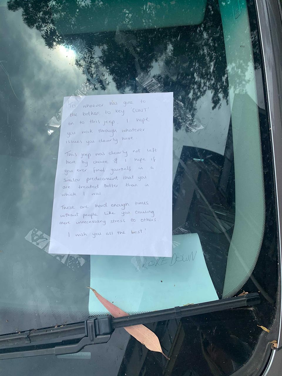 A jeep driver leaves a note in the window
