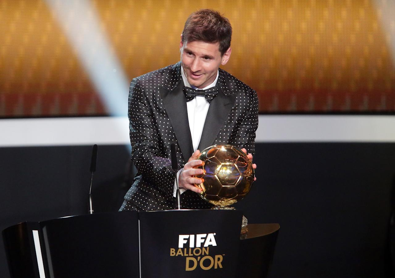 ZURICH, SWITZERLAND - JANUARY 07:  Lionel Messi of Argentina receives the FIFA Ballon d'Or 2012 trophy on January 7, 2013 in Zurich, Switzerland.  (Photo by Christof Koepsel/Getty Images)