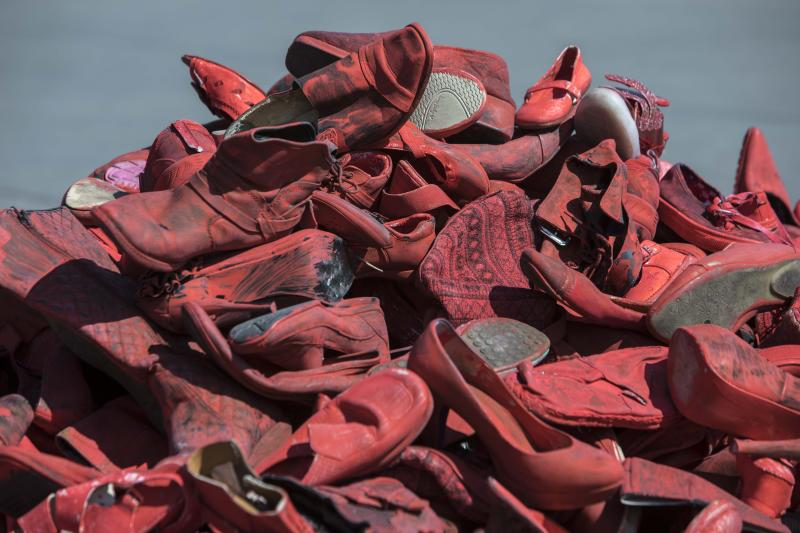 Women's red shoes are piled up in the Zocalo where they were placed by people to protest violence against women in Mexico City, Saturday, Jan. 11, 2020. There are 10 women killed daily on average across Mexico, and only one in 10 such crimes are solved, according to the National Citizens' Observatory on Femicide. (AP Photo/Christian Palma)