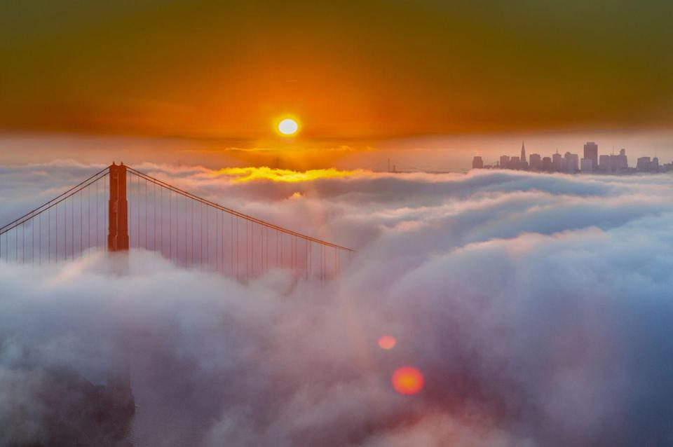 <p>You'll have to cross the San Francisco Bay to see the sun rise over the fog-covered iconic bridge. </p>