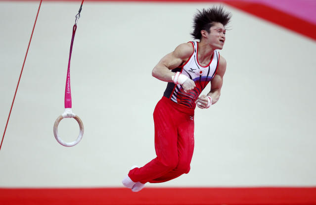 Kohei Uchimura of Japan dismounts after competing in the rings at the men's gymnastics qualification in the North Greenwich Arena during the London 2012 Olympic Games July 28, 2012. REUTERS/Brian Snyder (BRITAIN - Tags: SPORT OLYMPICS SPORT GYMNASTICS)