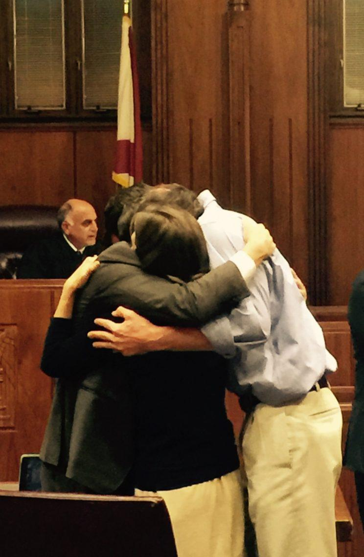 Caroline Malatesta embraces her husband and lawyer after winning a $16 million lawsuit over a traumatic birth experience that left her injured. (Photo: Courtesy Caroline Malatesta)