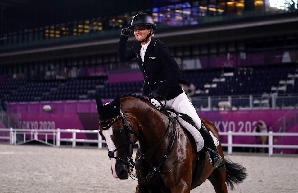 Julia Krajewski of Germany riding Amande De B'neville celebrates winning Gold in the Eventing Individual Jumping Final at Equestrian Park on the tenth day of the Tokyo 2020 Olympic Games in Japan. Picture date: Monday August 2, 2021. (Photo by Adam Davy/PA Images via Getty Images)
