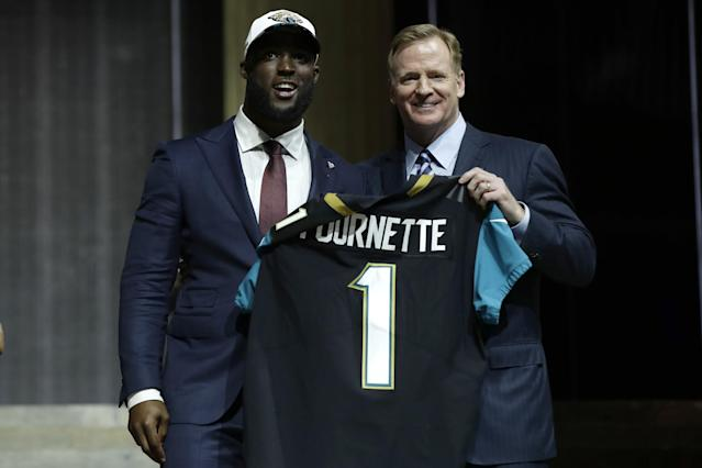 Leonard Fournette is greeted by NFL commissioner Roger Goodell after being taken fourth overall by the Jaguars. (AP)