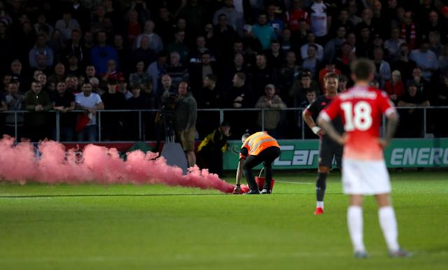 A flare thrown onto the pitch during Salford v Leeds (Martin Rickett/PA Wire)