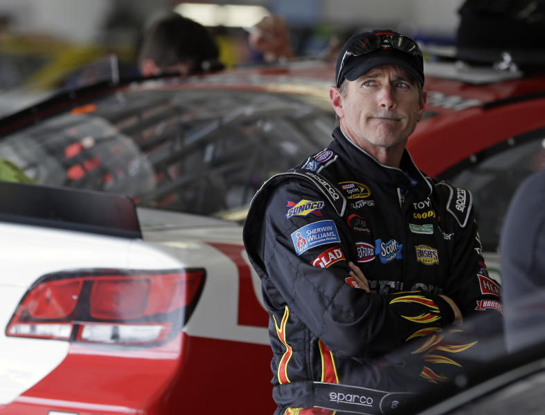Bobby Labonte waits in his garage during a practice session for the NASCAR Daytona 500 Sprint Cup Series auto race at Daytona International Speedway, Friday, Feb. 22, 2013, in Daytona Beach, Fla. (AP Photo/John Raoux)