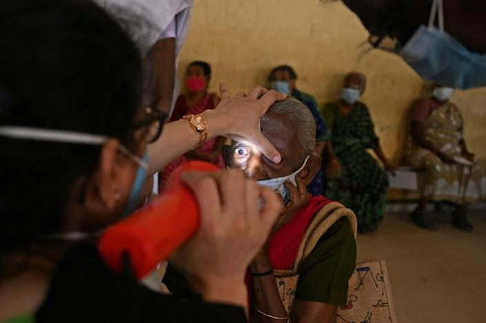 With a highly efficient assembly line model inspired by McDonald's, the network of hospitals of the Aravind Eye Care System performs half a million surgeries a year -- mostly for free (AFP/Arun SANKAR)