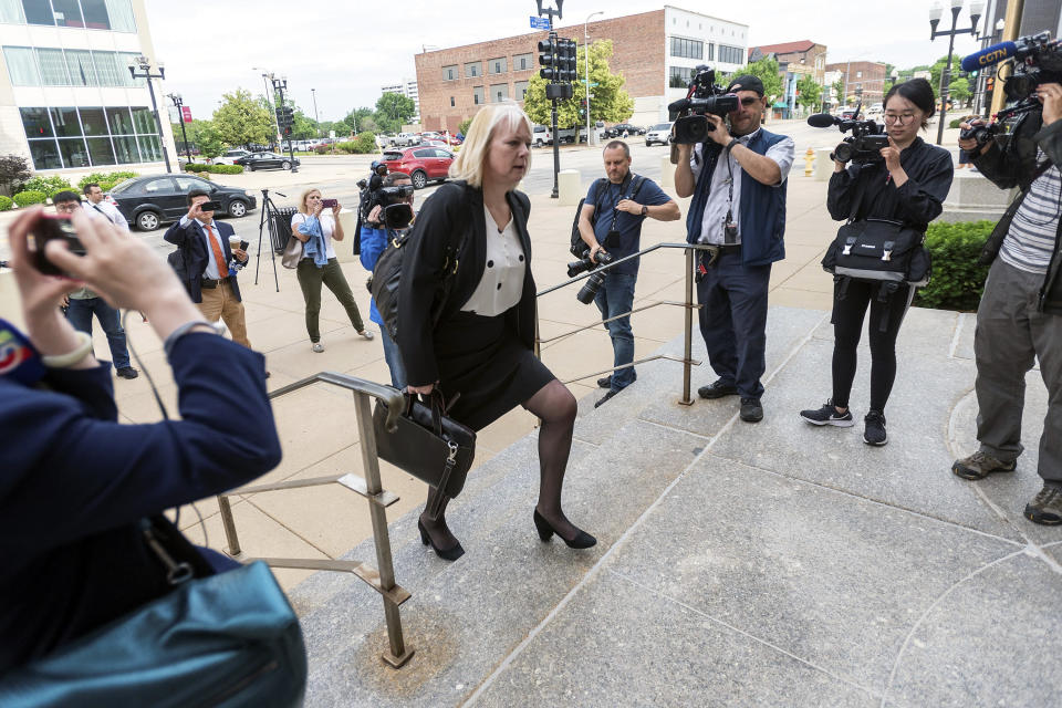 Defense attorney Julie Brain walks outside of the Federal Building and U.S. Courthouse Wednesday, June 12, 2019, in Peoria, Ill., before the trial of Brendt Christensen. (Stephen Haas/The News-Gazette via AP)