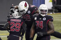 Arizona Cardinals running back Chase Edmonds (29) celebrates with Kelvin Beachum (68) and D.J. Humphries (74) after Edmonds scored a touchdown against the Seattle Seahawks during the second half of an NFL football game, Thursday, Nov. 19, 2020, in Seattle. (AP Photo/Elaine Thompson)