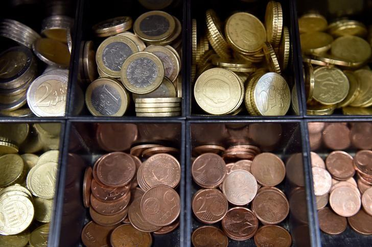 Euro coins are displayed in a shop in Brussels