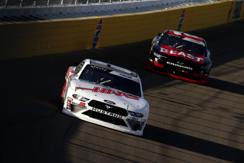 LAS VEGAS, NEVADA - SEPTEMBER 14: Cole Custer, driver of the #00 Haas Automation Ford, leads Tyler Reddick, driver of the #2 TAME the BEAST Chevrolet, during the NASCAR Xfinity Series Rhino Pro Trucks Outfitters 300 at Las Vegas Motor Speedway on September 14, 2019 in Las Vegas, Nevada. (Photo by Jonathan Ferrey/Getty Images)